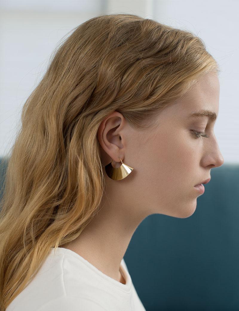 Kathleen Whitaker Small Gold Fan Earring profile on model