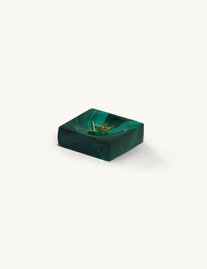 Kathleen Whitaker Malachite Ring Cup shown with a pair of Staple Studs resting inside