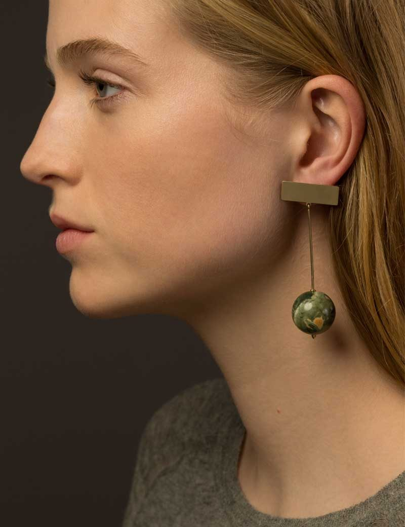 Kathleen Whitaker Rhyolite Bead hangs from Plane Stud Earrings